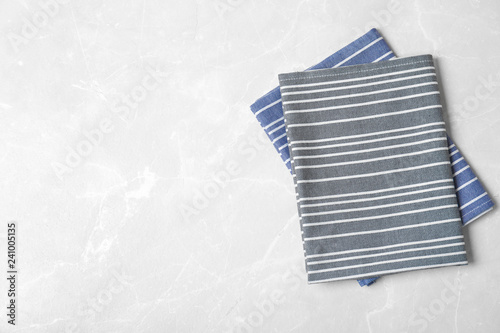 Fabric napkins and space for text on light background, top view