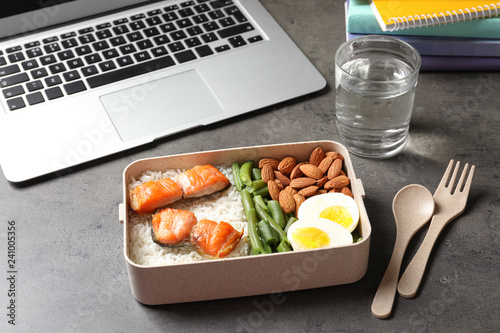 Container with natural protein food on office table