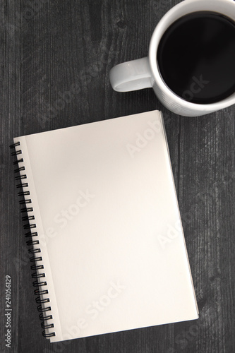 Fotografie, Obraz  A Blank Notebook Laid on a Black Wooden Table