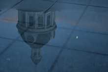 City Hall Reflected In Puddle