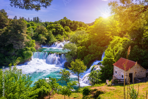 Photo Stands Forest river Waterfalls Krka, National Park, Dalmatia, Croatia. View of Krka National Park, Roski Slap location, Croatia, Europe. Beautiful world of Mediterranean countries. Traveling concept background.