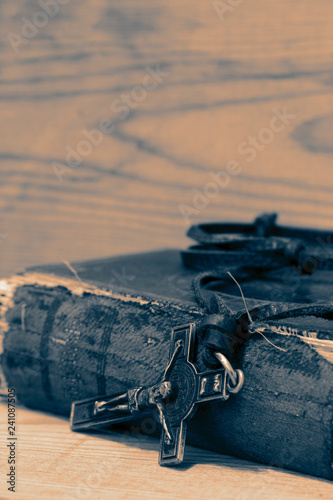Fotografie, Obraz  Crucifix necklace on a bible with wood background with colour toning