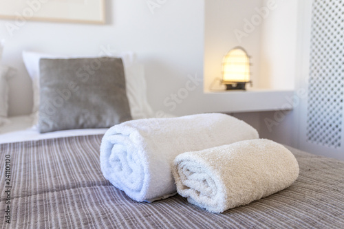Towels for body and for hands on the bed. Canvas Print