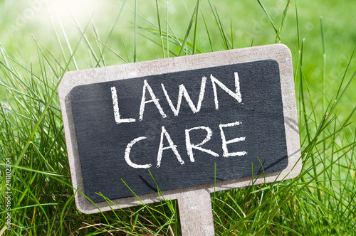 Chalkboard with garden equipment and lawn care