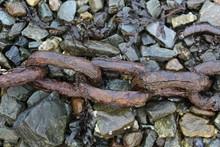 Rusty Chain On Beach