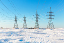 Electrical Pylons In The Snow