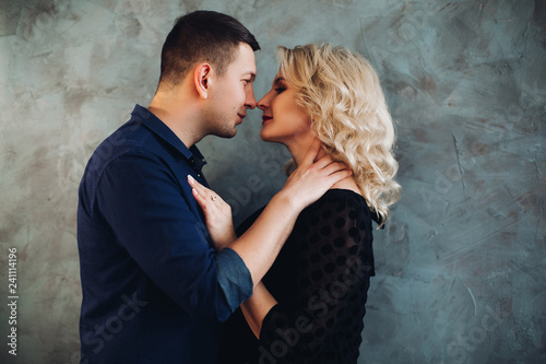Fotografie, Obraz  Portrait of sensual couple, man looking in the eye to his charming blonde woman