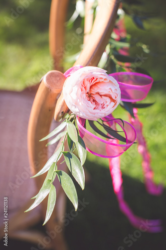 pink peony tied to back of chair Tablou Canvas