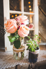 Country Wedding Florals In Vase With Succlents