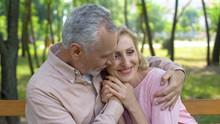 Happy Senior Couple Embraces I...