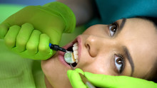Dentist Placing Sealant On Cen...