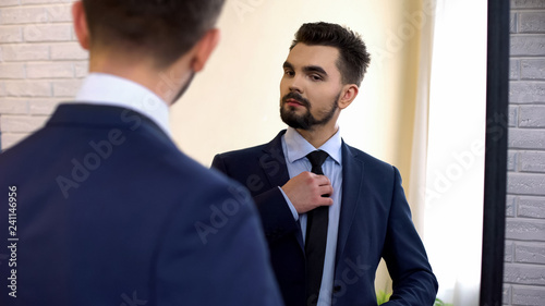 Man in business suit looking at mirror reflection, ready for work interview Canvas Print