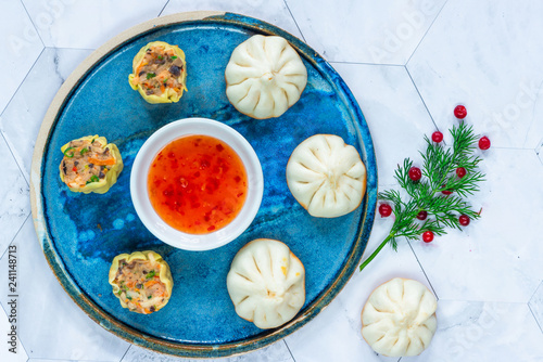 Selection of mini Chinese dumplings - dim sum with sweet chili dipping sauce. Party food idea. Top view.