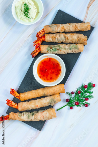 Giant king prawns with sweet chili and yogurt dipping sauces. Party food idea. Top view.