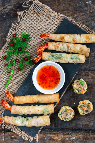 Giant king prawns and mini Chinese dim sum with sweet chili dipping sauce. Party food idea. Top view.