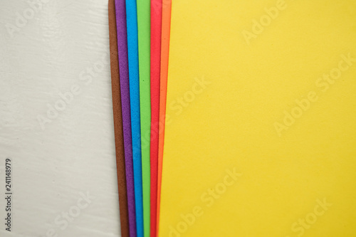 Valokuvatapetti Colorful eva foam sorted on white wooden background