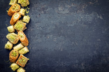Traditional Oriental Baklava Collection As Top View On A Black Board With Copy Space Right