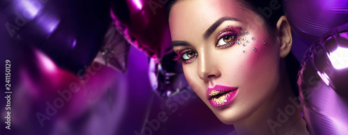 Poster Beauty Beauty fashion model girl creative art makeup with gems. Woman face over purple, pink and violet air balloons background