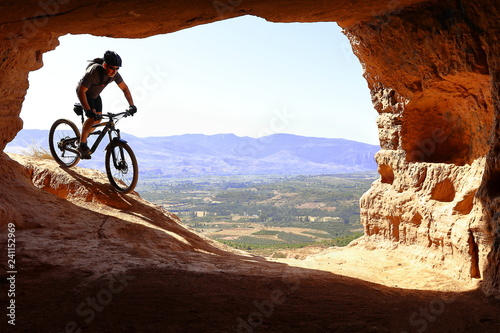 Garden Poster Brown RIDER MAN DESCENDING VERY FAST TO A CAVE WITH A MOUNTAIN BIKE