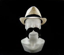 Styrofoam Head With A Straw Male Summer Hat With Black Long Moustache On Black Background