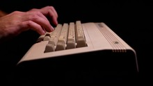 Typing On Old Computer In A Dark Room