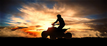 Young Man Rides An ATV Over Ba...