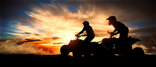 Two Young Men Ride An ATV On T...