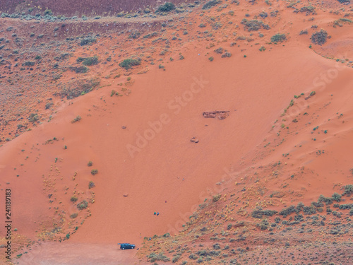 Canvas Prints Cuban Red Aerial photo of SUV car at the bottom of sand dune