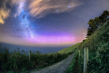 Beautiful Southern Lights Caught Together With Milky Way Galaxy In Dunedin, New Zealand. There Is A Small Narrow Path That Leads Toward To Ocean.  This View Amazing Because Heaven Meets The Earth.