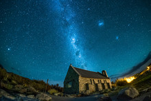 An Abandoned House Under The Beautiful Night Sky. There Are Stars And Milky Way. This Is A Famous Tourist Destination In New Zealand. This Image Has Star Trail To Show The Earth Rotation.