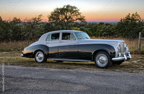 Fotografie, Obraz  Classic luxury car on rural road at sunset