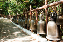 Many Big Metal Bell At Wat Phra That Doi Tung In Chiang Rai, Thailand