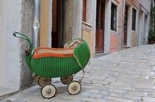 Vintage Baby Carriage On The Street