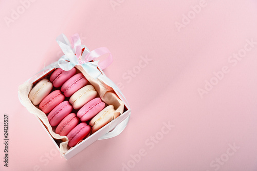 Fototapeta Pink macaroons in box on a pink background