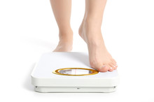 Female Feet Weighing Scale On A White Background Isolation