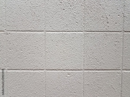 Fotografía  rough white or grey cement wall with squares