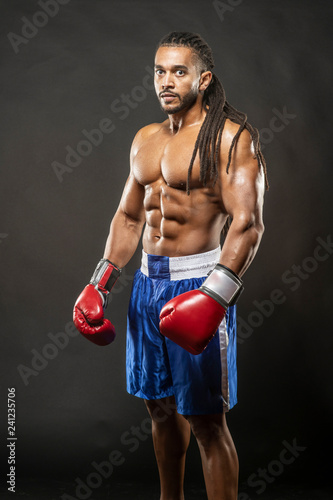 Fotografie, Obraz  Muscular African American Black male  boxer with dreadlocks hair stands menecenl