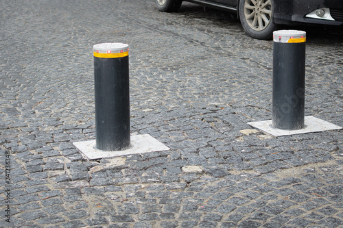 Fotografía  Automatic retractable bollard with glowing lights for control of road traffic an