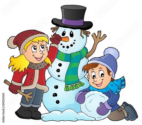 Kids building snowman theme image 1