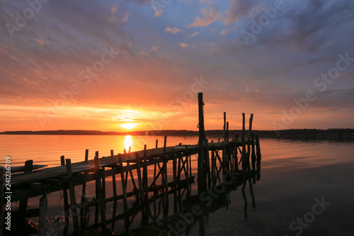 gorgeous seascape with romatic pier at sunset, burial at sea, sympathy card Fototapeta