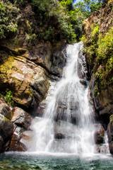 Fototapeta Wodospad cascading waterfall over the rocks