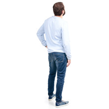 Man In Jeans Back Behind On A White Background. Isolation.