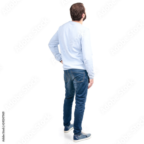 Fototapeta Man in jeans back behind on a white background. Isolation. obraz