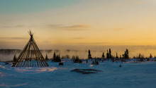 Cree Teepee Frame At Dusk By A Misty River In The Remote Northern Boreal Forest Of Quebec