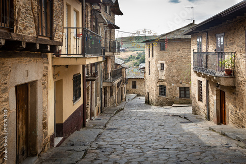 Fotografie, Obraz  a cobbled street with typical houses in Puebla de Sanabria town, province of Zam