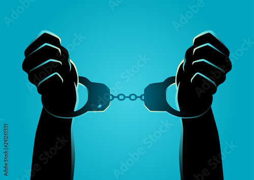 Photo Hands in handcuffs