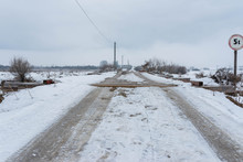 Old Wood Bridge Over Olt River At Wintertime In Romania   5 Ton Warning Street Sign.