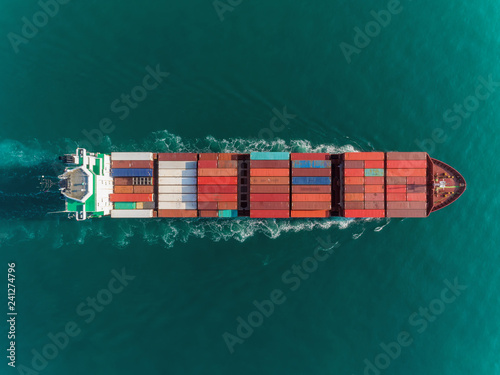 Aerial top view container ship full load container top speed