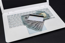 White Laptop With Dollars And Credit Card Isolated