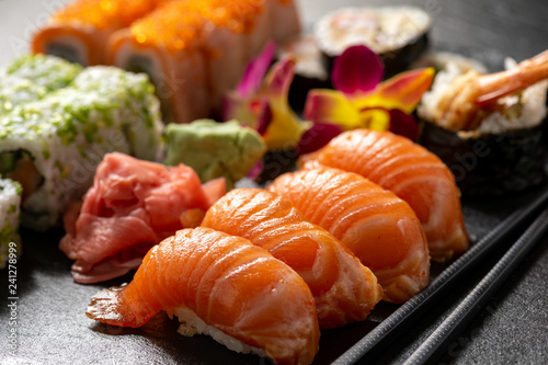 Poster de jardin Sushi bar Mix sushi set, on black stone background.